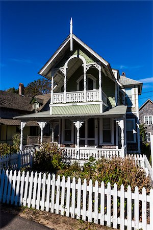 quaint house - House Exterior with White Picket Fence, Wesleyan Grove, Camp Meeting Association Historical Area, Oak Bluffs, Martha's Vineyard, Massachusetts, USA Stock Photo - Rights-Managed, Code: 700-06465755