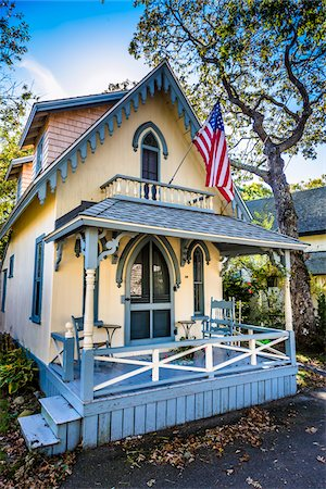 quaint house - House with Porch and American Flag, Wesleyan Grove, Camp Meeting Association Historical Area, Oak Bluffs, Martha's Vineyard, Massachusetts, USA Stock Photo - Rights-Managed, Code: 700-06465757
