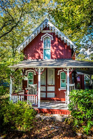 quaint house - Quaint Red House with Porch Surrounded by Trees and Shrubs, Wesleyan Grove, Camp Meeting Association Historical Area, Oak Bluffs, Martha's Vineyard, Massachusetts, USA Stock Photo - Rights-Managed, Code: 700-06465758
