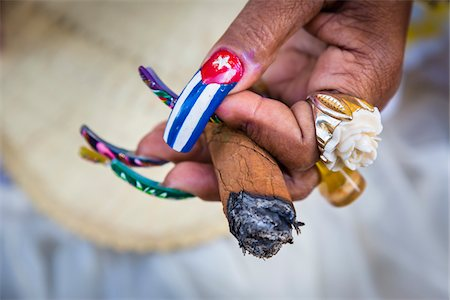 Close-Up of Senora Habana's Hands with Painted Fingernails and Holding Cigar, Plaza de la Catedral, Havana, Cuba Stock Photo - Rights-Managed, Code: 700-06465921