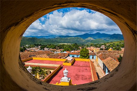 View of City Through Round Window from the Museo de la Lucha Contra Bandidos, Trinidad, Cuba Stock Photo - Rights-Managed, Code: 700-06465957