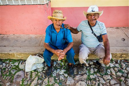 Portrait of Two Men Sitting on Curb and Smoking Cigars, Trinidad, Cuba Stock Photo - Rights-Managed, Code: 700-06465974
