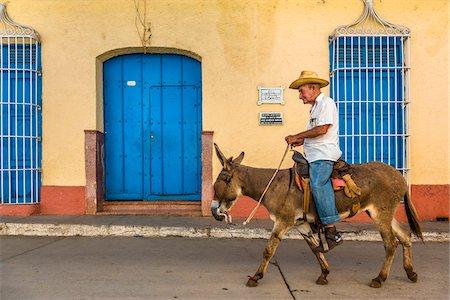 Man Riding Donkey, Trinidad, Cuba Stock Photo - Rights-Managed, Code: 700-06465975