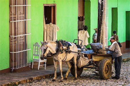 Man with Horse Drawn Cart in front of Green Building, Trinidad, Cuba Stock Photo - Rights-Managed, Code: 700-06465972