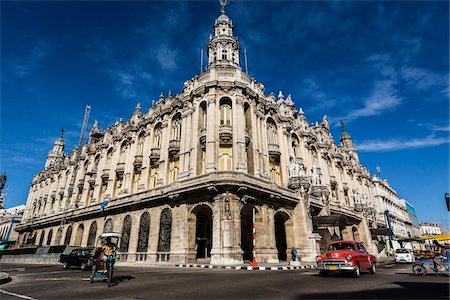 Traffic Passing by Great Theatre of Havana (Gran Teatro de La Habana) with Bright Blue Sky, Havana, Cuba Stock Photo - Rights-Managed, Code: 700-06486565