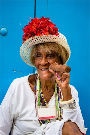 Portrait of Woman Wearing Hat and Smoking Large Cigar, Old Havana, Havana, Cuba Stock Photo - Rights-Managed, Code: 700-06486574