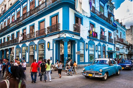 Blue Building, Classic Car, and Busy Street Scene, Havana, Cuba Stock Photo - Rights-Managed, Code: 700-06486575