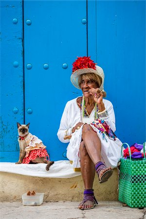 Woman Smoking Cigar and Sitting on Curb with Cat Wearing Costume, Old Havana, Havana, Cuba Stock Photo - Rights-Managed, Code: 700-06486581