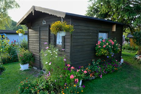 quaint - Small Wooden Garden House Surrounded by Blooming Flowers, Bavaria, Germany, Europe Stock Photo - Rights-Managed, Code: 700-06505725