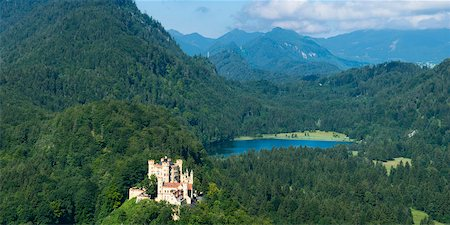 Panoramic View of Hohenschwangau Castle with Lake and Mountains in Background, Fussen, Ostallgau, Bavaria, Germany Stock Photo - Rights-Managed, Code: 700-06531642