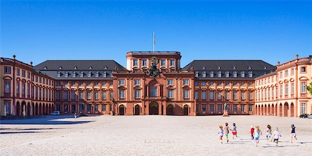 school - Mannheim Palace, the city castle and main building of the University of Mannheim, with children running in courtyard, Baden-Wurttemberg, Germany Stock Photo - Rights-Managed, Code: 700-06531652