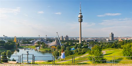 Olympiapark, constructed for the 1972 Summer Olympics, with Olympiaturm in the background, Munich, Oberbayern, Bavaria, Germany Stock Photo - Rights-Managed, Code: 700-06531677