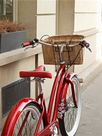 Close-up of red, classic, road bicycle with wicker basket attached to handlebars, Paris, France Stock Photo - Rights-Managed, Code: 700-06531924