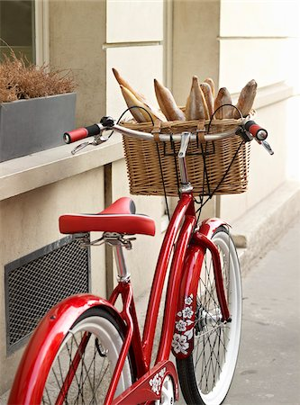 red, classic, road bicycle with wicker basket attached to handlebars filled with baguettes from bakery, Paris, France Stock Photo - Rights-Managed, Code: 700-06531925