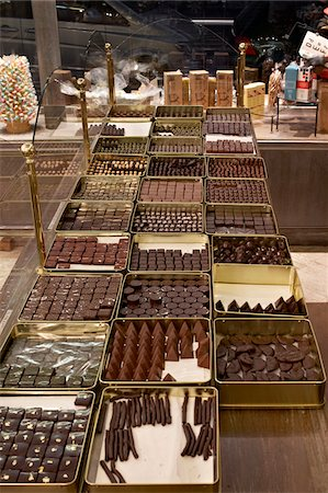 Assortment of chocolate truffles on display in candy shop, Le Bonbon Royal, Paris, France Stock Photo - Rights-Managed, Code: 700-06531934