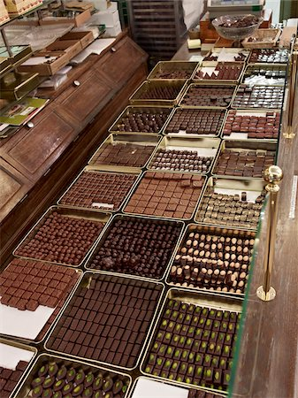Assortment of chocolate truffles on display in candy shop, Le Bonbon Royal, Paris, France Stock Photo - Rights-Managed, Code: 700-06531933