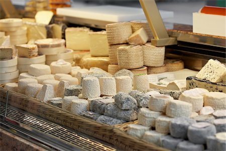 supermarket not people - Fresh wedges and rounds of French goat cheese in artisan cheese shop, La Fromagerie, Paris, France Stock Photo - Rights-Managed, Code: 700-06531958