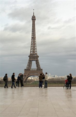 Tourists at the Eiffel Tower in overcast, rainy weather, Eiffel Tower, Paris, France Stock Photo - Rights-Managed, Code: 700-06531964
