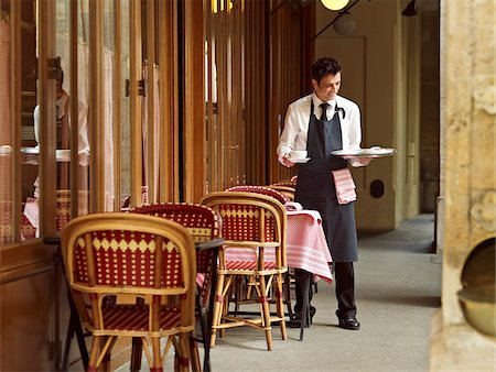 waiter clearing dishes at charming outdoor cafe, Fontaine de Mars, Paris, France Stock Photo - Rights-Managed, Code: 700-06531967