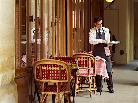 waiter clearing dishes at charming outdoor cafe, Fontaine de Mars, Paris, France Stock Photo - Rights-Managed, Code: 700-06531968