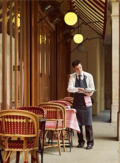 waiter clearing dishes at charming outdoor cafe, Fontaine de Mars, Paris, France Stock Photo - Premium Rights-Managed, Artist: Michael Mahovlich, Image code: 700-06531969