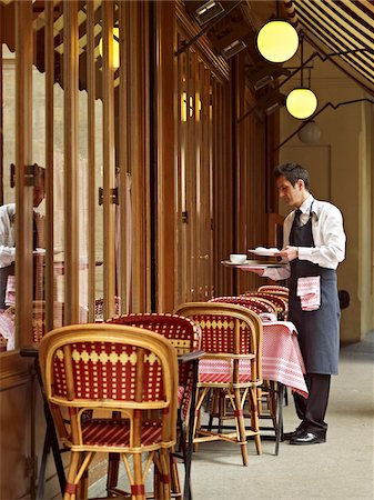 waiter clearing dishes at charming outdoor cafe, Fontaine de Mars, Paris, France Stock Photo - Rights-Managed, Code: 700-06531970