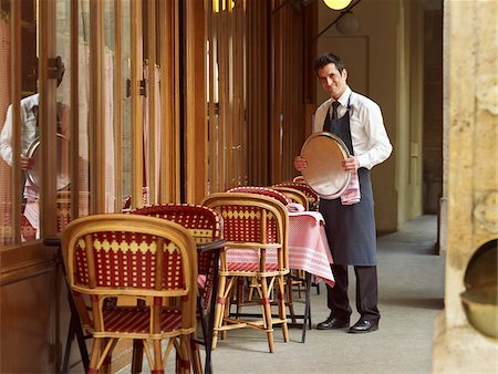 french (places and things) - Portrait of Waiter Holding Tray at Charming Outdoor Cafe, Fontaine de Mars, Paris, France Stock Photo - Rights-Managed, Code: 700-06531971