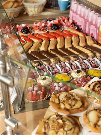 presentation (displaying) - assorted sweet pastries and baked goods arranged in rows in glass bakery display case on countertop Stock Photo - Rights-Managed, Code: 700-06531980