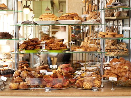 delicious - assorted pastries and baked goods stacked on display on glass shelves on bakery counter Stock Photo - Rights-Managed, Code: 700-06531981