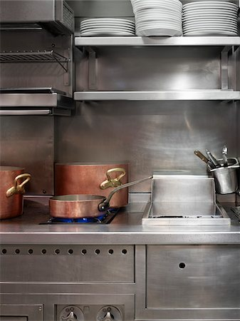 copper pots on commercial stainless steel stove in restaurant kitchen Stock Photo - Rights-Managed, Code: 700-06531982