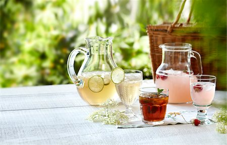 Three summer cordial beverages with mint, lime, and strawberry in an outdoor setting Stock Photo - Rights-Managed, Code: 700-06532024