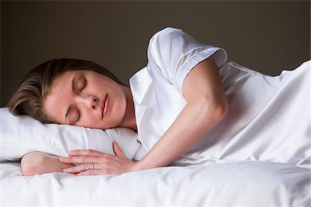 Portrait of sleeping woman on her bed in her bedroom. Stock Photo - Rights-Managed, Code: 700-06553298