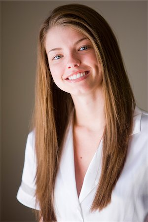 silky - Portrait of Smiling Woman with Long Brown Hair Stock Photo - Rights-Managed, Code: 700-06553293