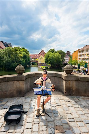sheet music - Boy Playing Accordian during Annual Summer Music Festival of Bardentreffen (The meeting of the bards), Nuremberg, Middle Franconia, Bavaria, Germany Stock Photo - Rights-Managed, Code: 700-06553336