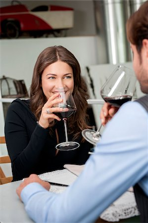 Couple in Restaurant Drinking Red Wine Stock Photo - Rights-Managed, Code: 700-06553389