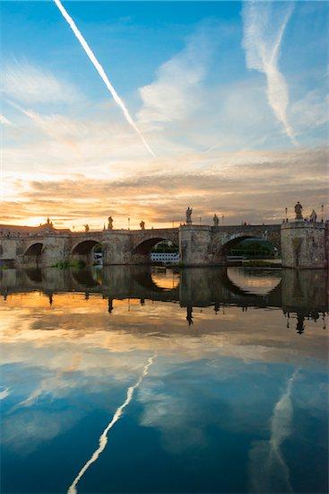 Old Stone Arch Bridge over the Main River at Dusk, Wuerzburg, Lower Franconia, Bavaria, Germany Stock Photo - Premium Rights-Managed, Artist: Siephoto, Image code: 700-06553380