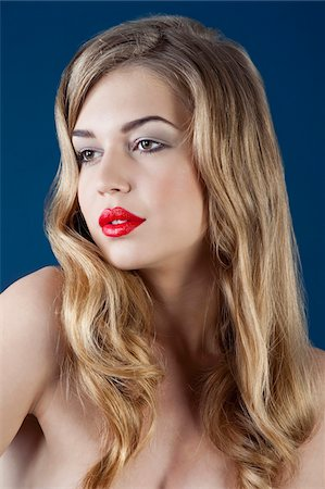 Portrait of Woman with Long Blond Hair and Wearing Red Lipstick Stock Photo - Rights-Managed, Code: 700-06553398