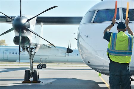 airport ramp marshall signalling plane in for arrival Stock Photo - Rights-Managed, Code: 700-06570966
