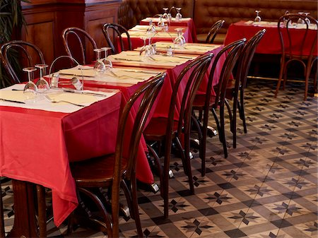 red chair - tables set with red tablecloths, wine glasses and cutlery in restaurant, Paris, France Stock Photo - Rights-Managed, Code: 700-06626975