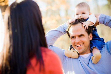 Man Carrying Four Month Old Daughter on his Shoulders while Talking with Woman, Outdoors at Scanlon Creek Conservation Area, near Bradford, Ontario, Canada Stock Photo - Rights-Managed, Code: 700-06674976