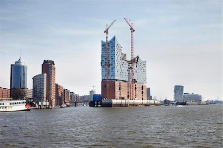 Elbe Philharmonic Hall with Construction Cranes on Elbe River, HafenCity, Hamburg, Germany Stock Photo - Rights-Managed, Code: 700-06679330