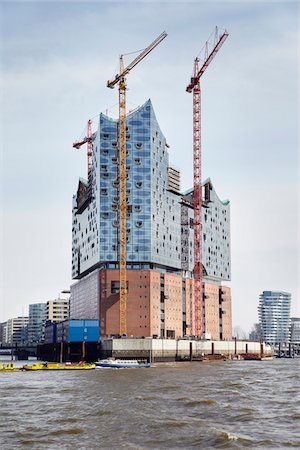 flat - Elbe Philharmonic Hall with Construction Cranes on Elbe River, HafenCity, Hamburg, Germany Stock Photo - Rights-Managed, Code: 700-06679345