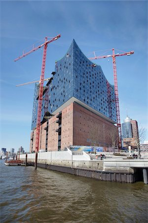 Elbe Philharmonic Hall with Construction Cranes on Elbe River, HafenCity, Hamburg, Germany Stock Photo - Rights-Managed, Code: 700-06679341