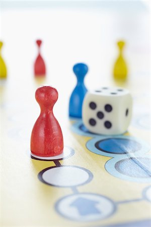close-up of ludo board game with colored playing pieces and dice Stock Photo - Rights-Managed, Code: 700-06679355