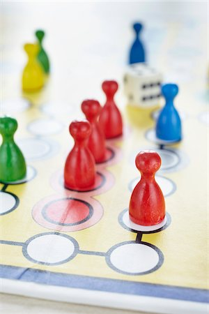 close-up of ludo board game with colored playing pieces and dice Stock Photo - Rights-Managed, Code: 700-06679357