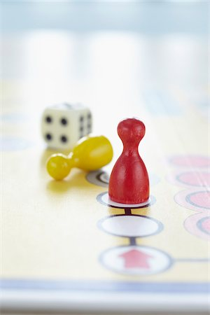 close-up of ludo board game with colored playing pieces and dice Stock Photo - Rights-Managed, Code: 700-06679359