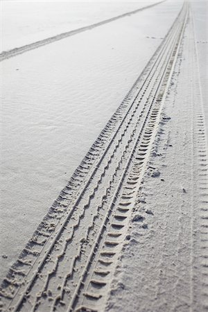 tire tracks in wet sand on the beach Stock Photo - Rights-Managed, Code: 700-06679365