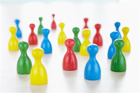 strategy - close-up of multi-colored playing pieces on white background Stock Photo - Rights-Managed, Code: 700-06679363