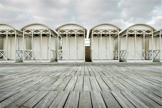 WOODEN BEACH HUTS ON THE BEACH ON A WINTER DAY, OSTIA LIDO, ROME, ITALY Stock Photo - Premium Rights-Managed, Artist: Siephoto, Image code: 700-06685216