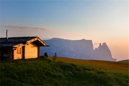 Wooden cabin with Seiser Alm and Schlern mountains at sunset, South Tyrol, Trentino Alto Adige, Italy Stock Photo - Rights-Managed, Code: 700-06701751